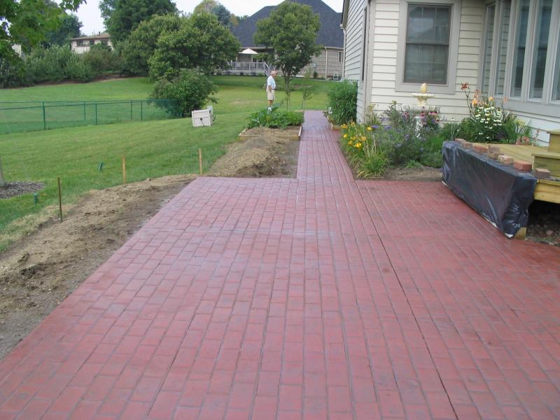 Stamped concrete patio imprinted to look like brick pavers
