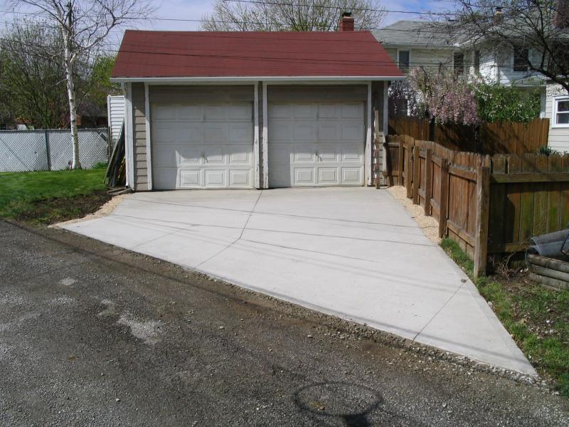 Broom finished concrete with saw cuts is the most durable yet economic driveway