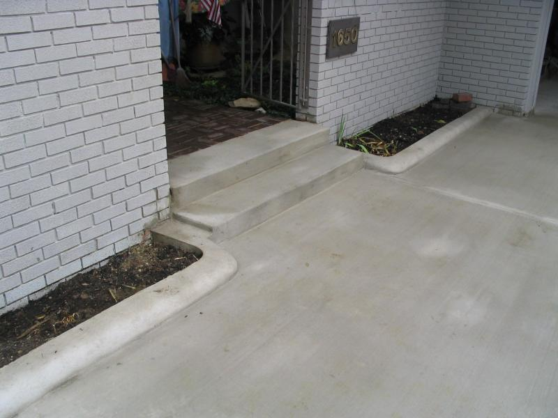 Standard concrete driveway with flower bed curb