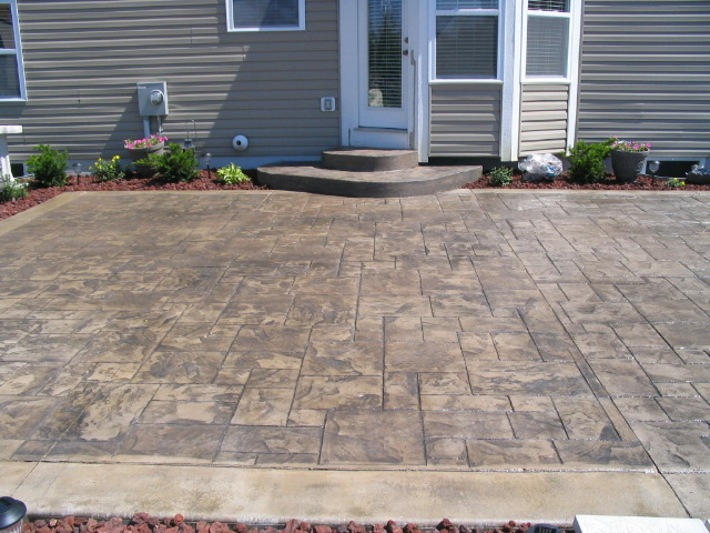 Grand Ashler Slate stamped concrete w/ solid boarder. Scofield and Brickform