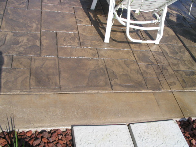 Porcelain grey, medium grey and smoky beige patio with boarder in Delaware, Ohio