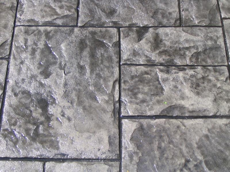 picture of Grand Ashler Slate stemped finish concrete up close withdark greys