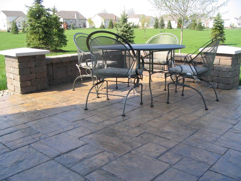 Grand Ashler Slate stamped concrete with Brussels Dimensional Stone walls