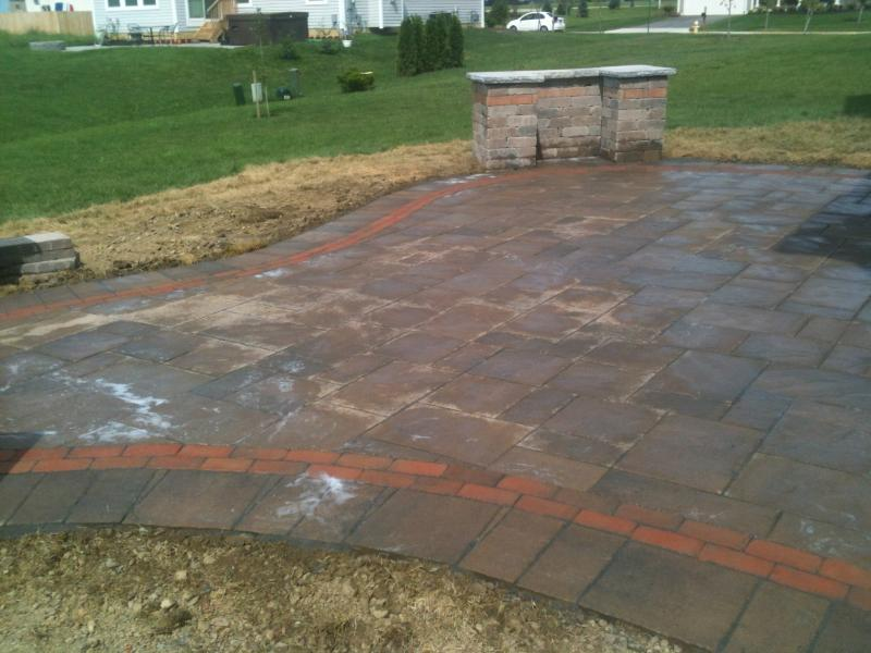 Paver patio with grill surround and a brick inlay for accent.