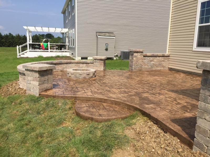 Stamped patio with walls and fire pit.