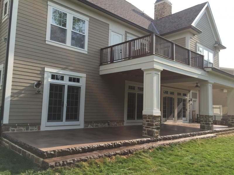 Colored broom finish porch with stone step liners