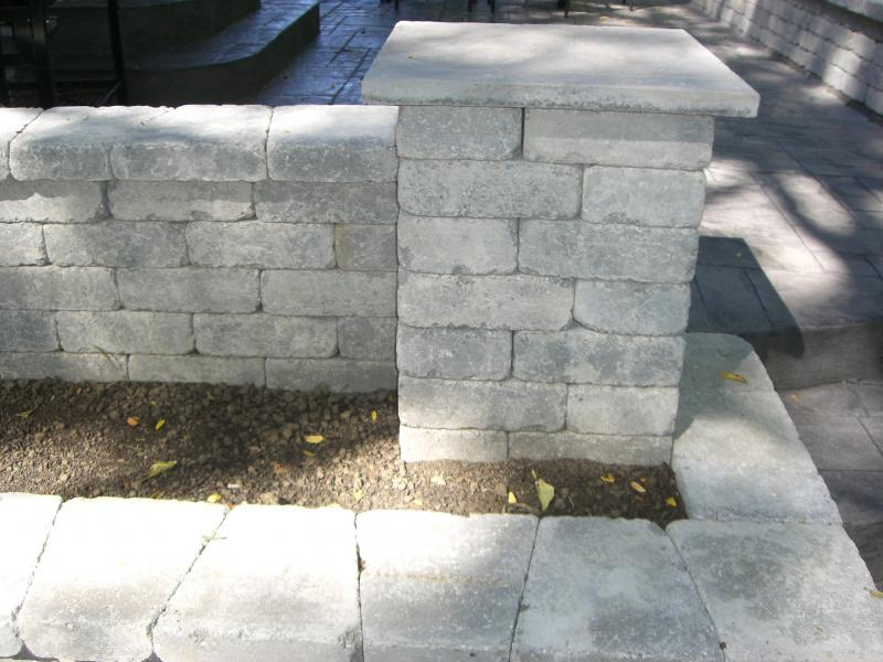 Planter between seating wall and retaining wall with raised patio and steps