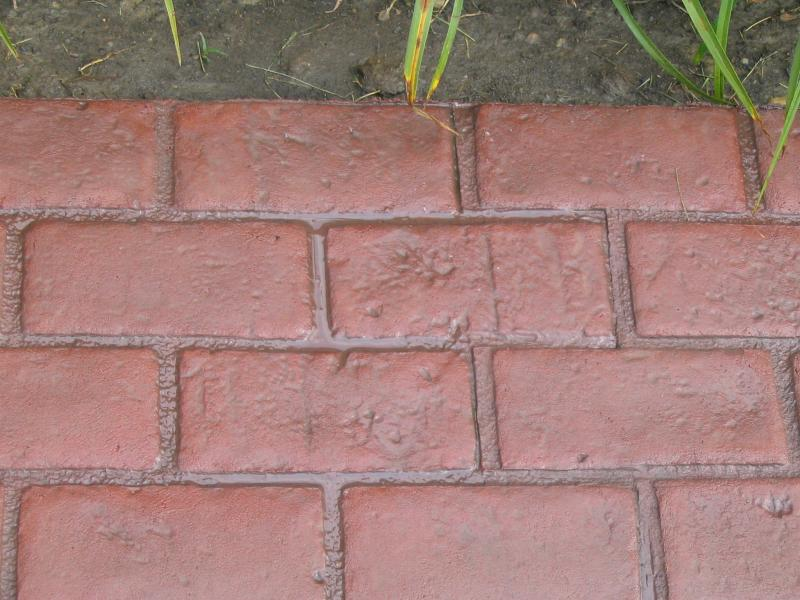 Red and grey brick stamped concrete patio and sidewalk