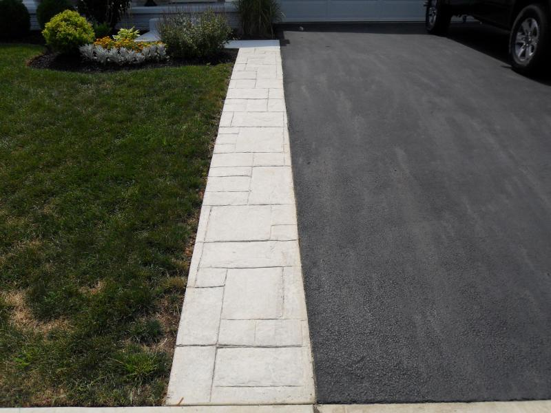 Perfect way to widen an asphalt driveway while adding a walkway.