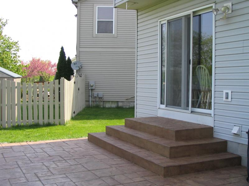 Square concrete wedding cake steps with grand ashler slate stamped patio