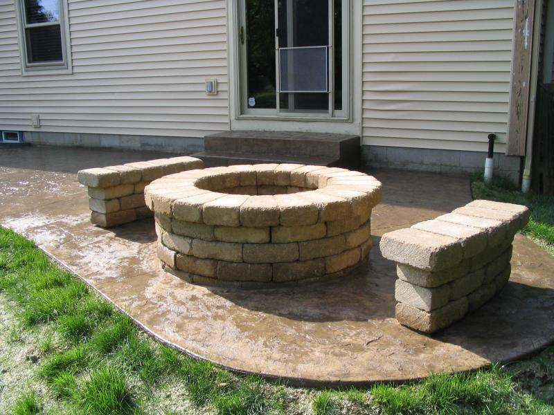 Textured Skin stamped finish concrete with paver fire pit and seating benches