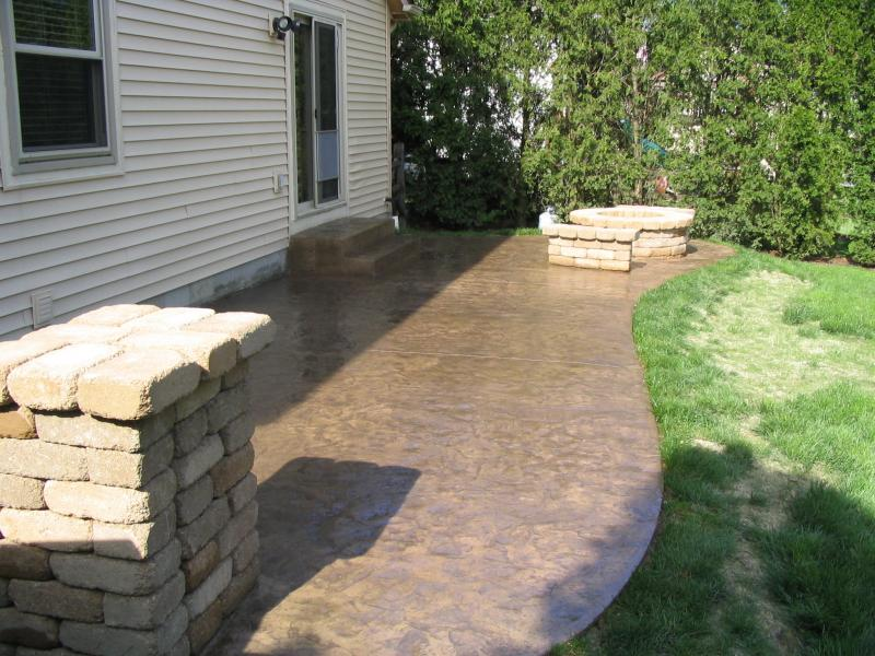 Textured stamped finish with grill island, fire pit and seating