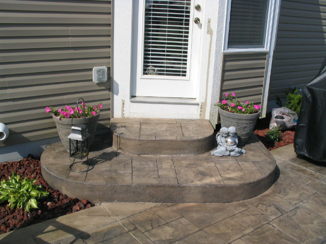 Grand Ashler Slate stamped concrete with unstamped boarder and rounded steps