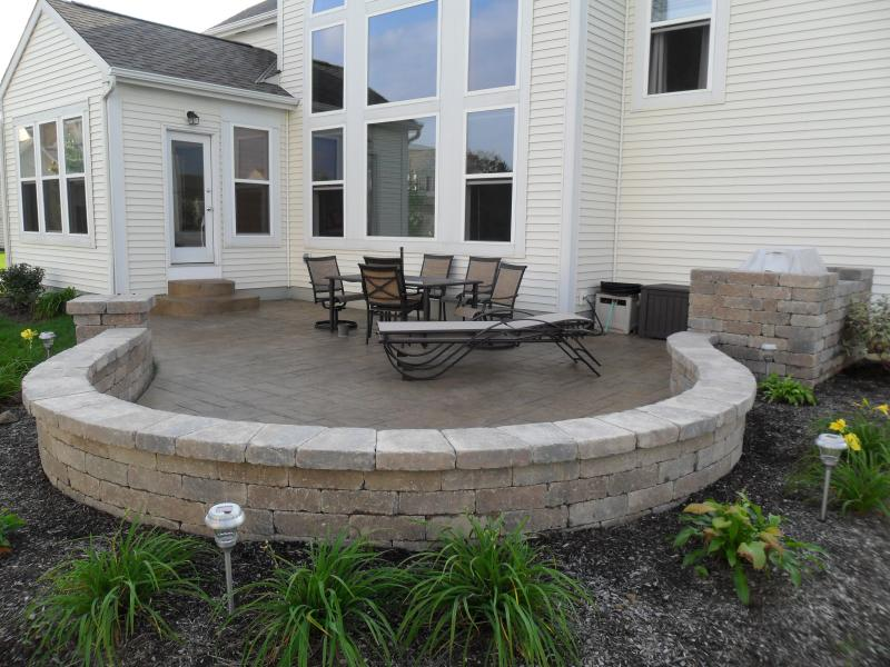 Amazing Stamped Concrete Patio Picture With Paver Seating Wall In Blacklick, Ohio.