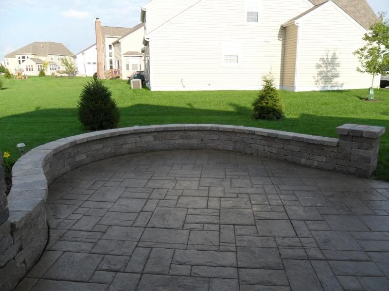 Decorative concrete picture with seating wall.